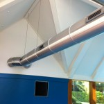 An image showing a ventilation system across pool room installed by Vent Logistics